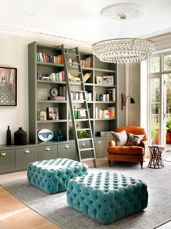ChicDecó: | An eclectic family home in London | maybe not the cushions, but love the bookcase