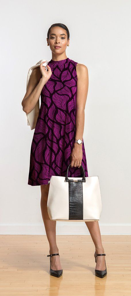 Sleeveless swing dress with mock-neck, great summer office look or for an evening out