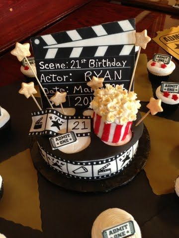 Movie theme birthday cake with cupcakes to match. Popcorn made with cupcakes and fondant.
