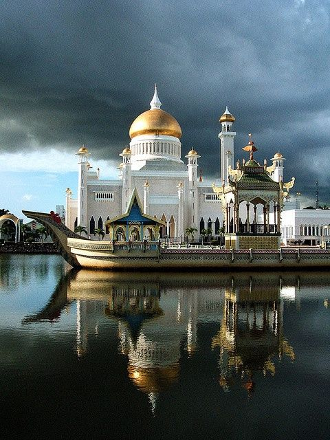 Mosque is named Sultan Omar Ali Saifuddin III.  It is a royal Islamic mosque, in Bandar Seri Begawan, which is the capital of the sultanate of Brunei.  The ceremonial barge is in the foreground.