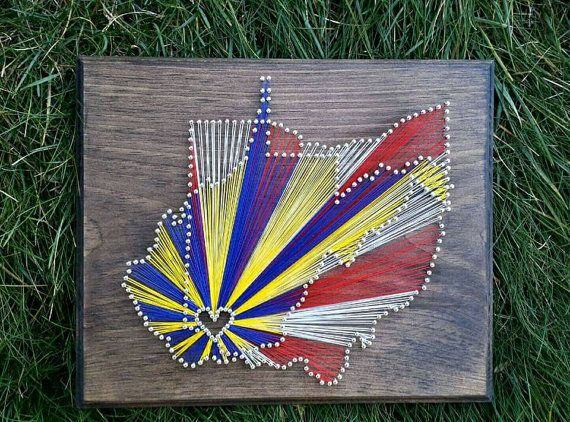 A house divided!  Ohio State and West Virginia University string art!  Any color combination and any state combination available on Etsy!  https://www.etsy.com/listing/219745269/two-state-string-art-with-multicolored
