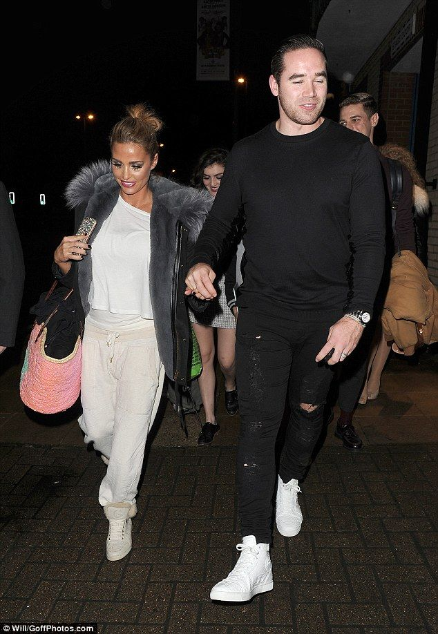 Showing his support: Katie Price (left) left Woking's New Victoria Theatre with her husban...