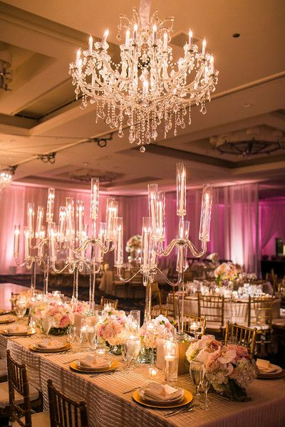 Elegant, glam pink + gold wedding centerpiece idea - tall crystal candelabras with short pink + white floral arrangements with gold chargers + crystal chandelier {Lin and Jirsa Photography}
