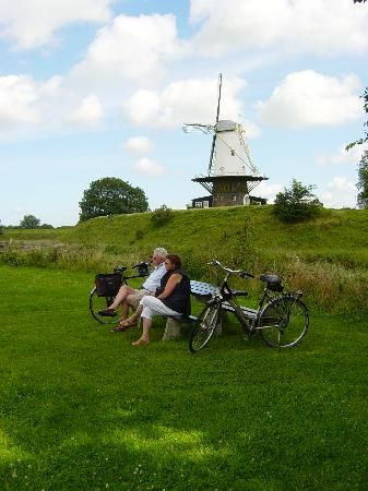 Vlissingen, Zeeland, Netherlands - Cycling with windmills