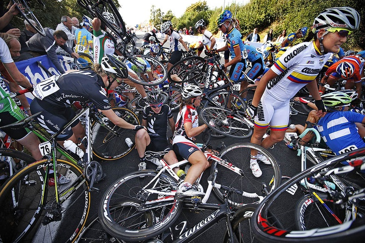 Serika Guluma Ortiz of Colombia, right, Linda Villumsen of New Zealand, left, and other riders get up after a crash of the pack during the women's road race of the Cycling World Championship in Valkenburg, the Netherlands.