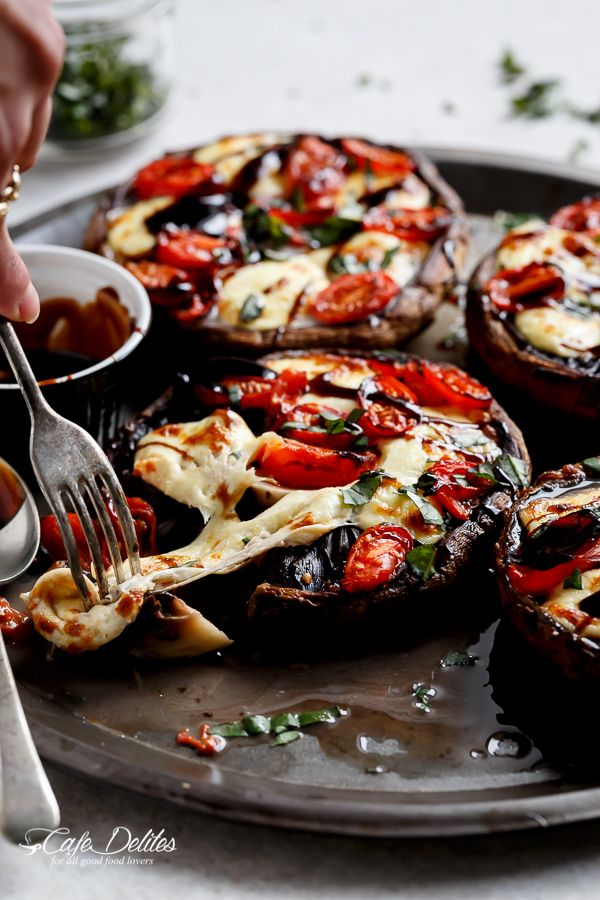 Caprese Stuffed Garlic Butter Portobellos by cafedelites: Garlic buttered Portobello Mushrooms stuffed and grilled with fresh mozzarella cheese, tomato slices and fresh shredded basil leaves and drizzled with a rich balsamic glaze. #Mushrooms #Portobello #Caprese