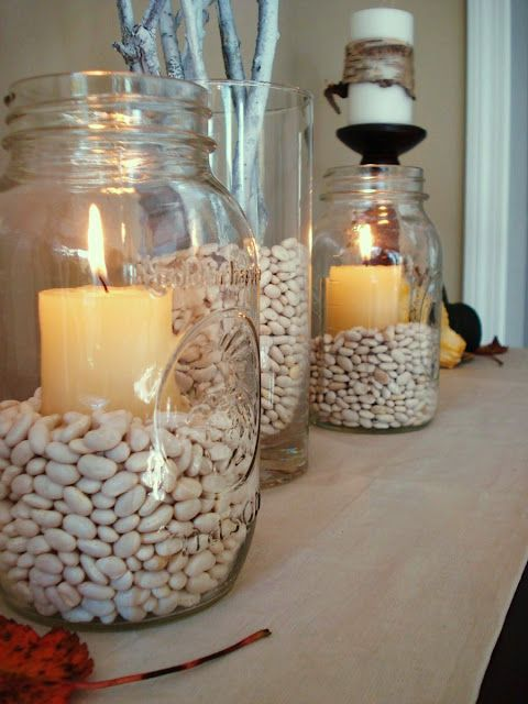 oversize jars as candle holders with white beans as filler... or rice, or something else cheap w/ a bit of neutral color. (JX hates split peas & lentils, so I'd want to avoid that) :)