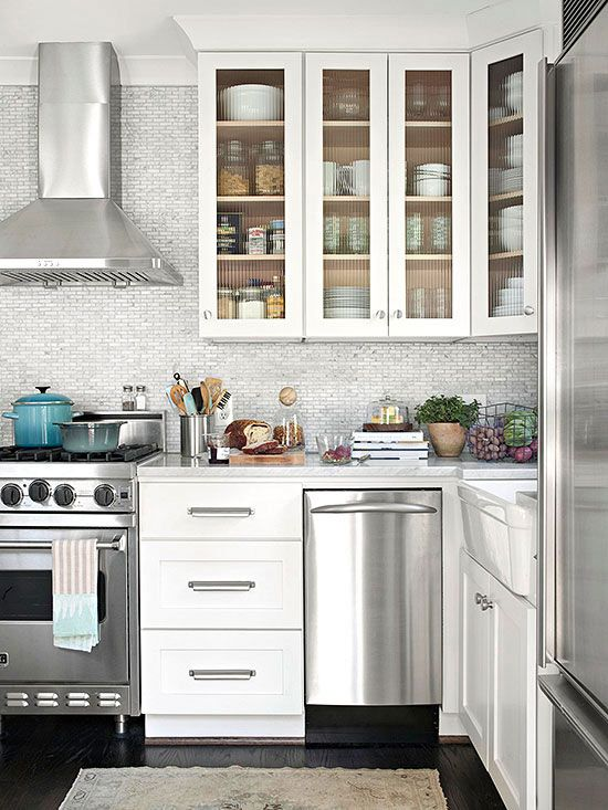 Small Kitchen, Big Ideas - Slimmed down appliances, including a 24-inch-wide gas range, 18-inch dishwasher and a 27-inch-wide refrigerator with ribbed glass in cabinet doors.