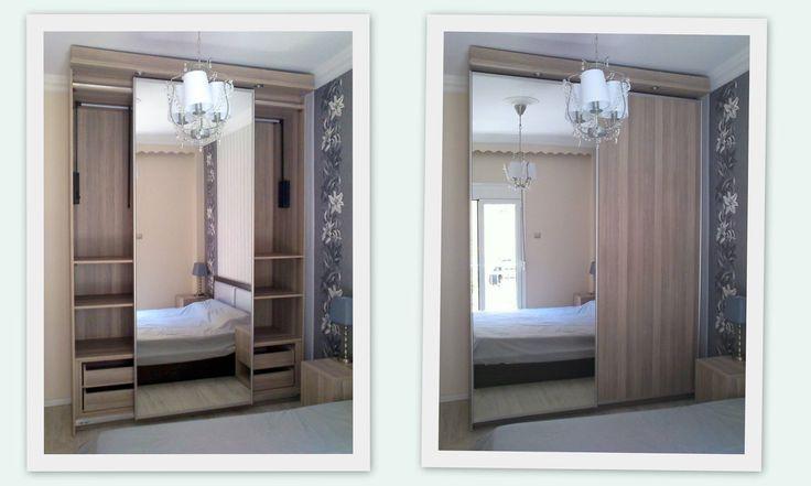Ντουλάπα με συρόμενες πόρτες βαρέου τύπου από ανάγλυφη μελαμίνη, καθρέφτη και σποτάκια.