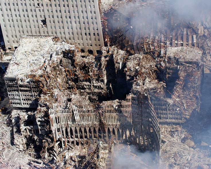 Five days after the terrorist attacks, ruins of the New York World Trade Center…