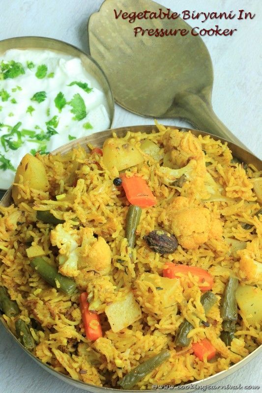 Monday night and hubby came home from office. He said please make Biryani for dinner. I was not in a mood to make biryani in authentic way. So made it in Pressure cooker. I often make Vegetable Biryani, pulao or any rice preparation In Pressure Cooker when I don't have enough time or feeling lazy ;). Vegetable Biryani is made many ways. Authentic Way of making Vegetable Biryani takes long time and many spices. This Vegetable Biryani In Pressure Cooker is easy to make yet tastes yum. I would