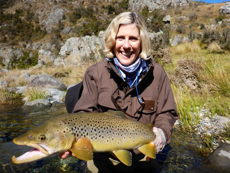 Nancy as happy as they come with her New Zealand brown trout trophy. www.southernriversflyfishing.co.nz