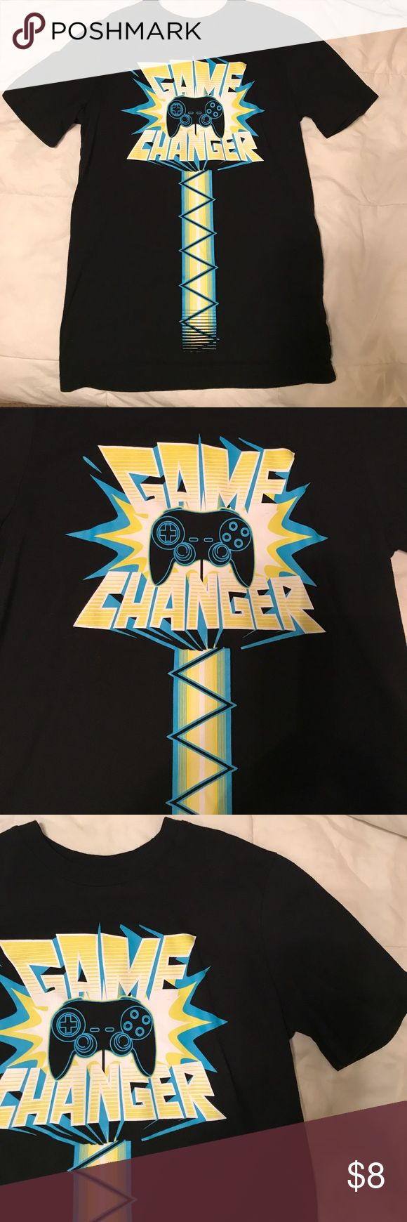 Boys graphic T-shirt Black T-shirt with game changer graphic and video game controller. Graphic is in shades of teal, white and a yellowish green. Never worn. Size large 12/14. Price is negotiable, please use the offer button discounts on bundles. Circo Shirts & Tops Tees - Short Sleeve