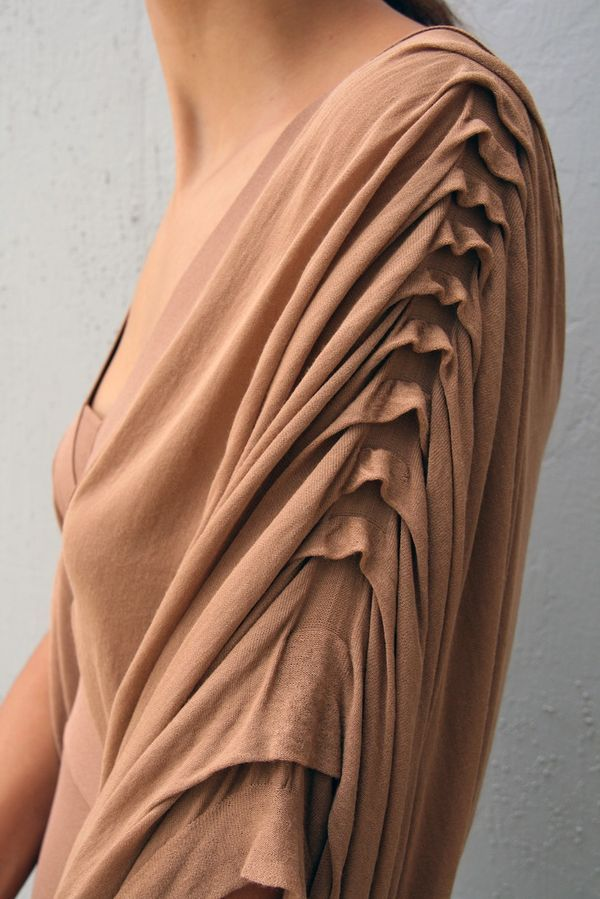 Beautiful idea for a sleeve. Would definitely be an excellent idea to drape. The way the fabric falls down like cowls would need to be experimented with to get the perfect drape/hang.