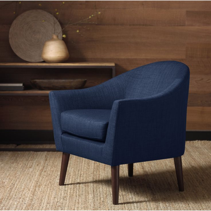 For any style from transitional, to modern, to minimalist, you can't go wrong with this navy blue colored arm chair. The Grayson chair features wooden legs and allover padding, designed with a sleek wrap-around shape.
