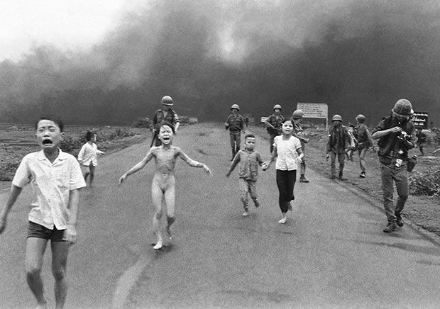 Crying children, including 9yr-old Kim Phúc, run down Route 1 near Trảng Bàng, Vietnam, after an aerial napalm attack by the South Vietnamese Air Force on suspected Viet Cong hiding places as forces from the 25th Division walk behind them. The Pulitzer Prize-winning photograph taken by AP photographer Nick Ut on the 8th of June 1973 is one of the most memorable photographs of the 20th century.  Photo: Associated Press / Nick Ut