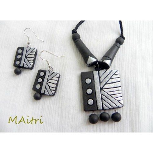 Terracotta Jewellery_Silver Black Square :  A simple and elegant piece of terracotta art, in the form of a contemporary necklace set in shades of silver and black !! Wonderfully enhances your casual and western appearance !!!    Product Care : Though unbreakable, may be damaged if thrown forcefully !    Size - Pendant size : 2.8 cm, each side of the square with a long thread attahced ! Earrings : 1.8 cm each side of the square !    maitri_crafts@yahoo.com…