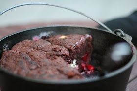 Chocolate cake with cherry pie filling and cream cheese. Dutch oven recipe