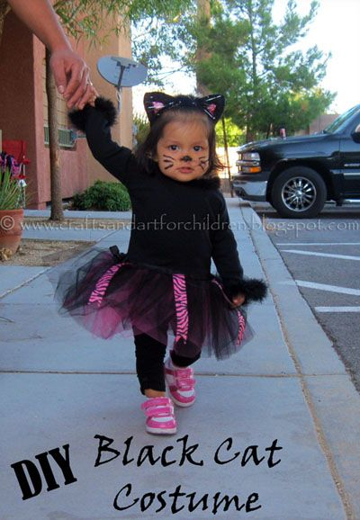 Last Halloween I couldn't find a baby/toddler black cat costume that I thought was cute enough, so I decided to make one for my little girl instead. This was my 1st attempt ever at making a costume {and I definitely am not a sewing expert…lol!}, but I think it turned out cute. 10 months old . . . . .