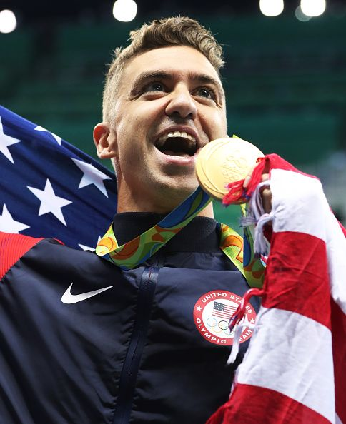 Anthony Ervin of United States poses with his Gold medal from the Men's 50m…he's 35 yrs old.