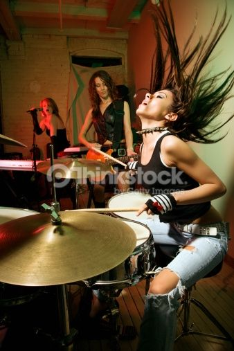 Stock Photo : Caucasian girl band playing instruments.