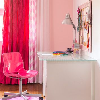 Play on various shades of pink by mixing and matching office accessories and textures, like this combination of fuchsia and herringbone patterned curtains.