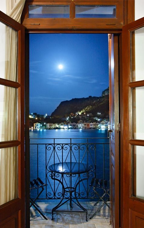 Moonlight Seranade…picturesque harbor of Kastellorizo, Greece. Photo by Cretense.