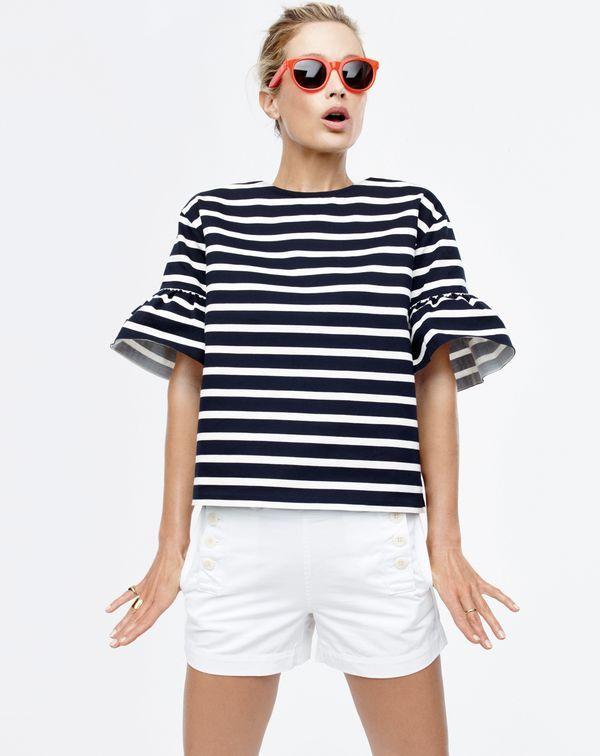 J.Crew women's ruffle-sleeve top, chino sailor short and Sam sunglasses.