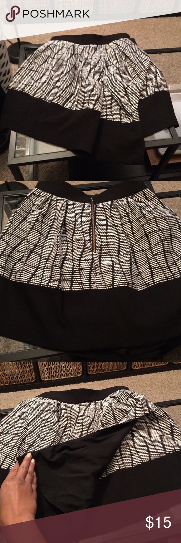 Banana Republic black and white high waisted skirt Great winter layering skirt!!!! Black and white stitching. I have only worn it once and it no longer fits. Wonderful day to night piece from banana republic Banana Republic Skirts Midi