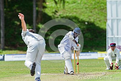 Batman plays ball,cricket game action with batsmen and bowlers  between Westville plays Durban Boys High 1st Teams school derby.