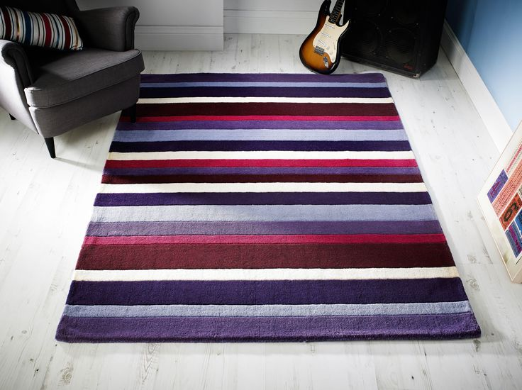 Handmade using 100% premium wool fibre, Jazz Stripes Purple Rug comes with both design and comfort factor. #purplerugs #purplewoolrugs #woolrugs #modernrugs #luxuryrugs