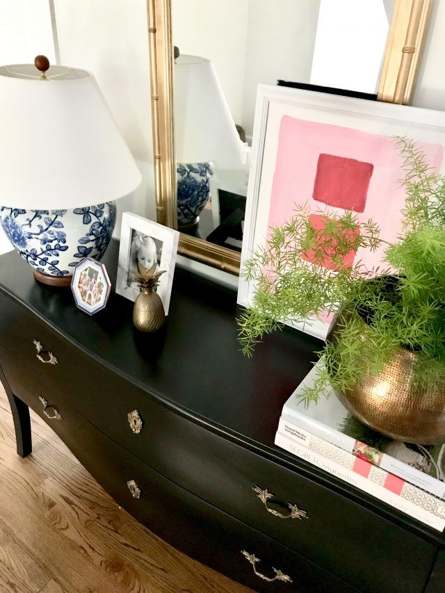 accessorizing-traditional-furniture console styling upstairs landing, black bombay chest, blue white lamp, brass planter, asparagus fern, abstract art, gold bamboo mirror