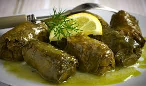 DOLMADAKIA are fresh vine leaves hugging rice (often accompanied by ground beef) and spices. Usually served in olive oil and lemon or special mustard sauce.