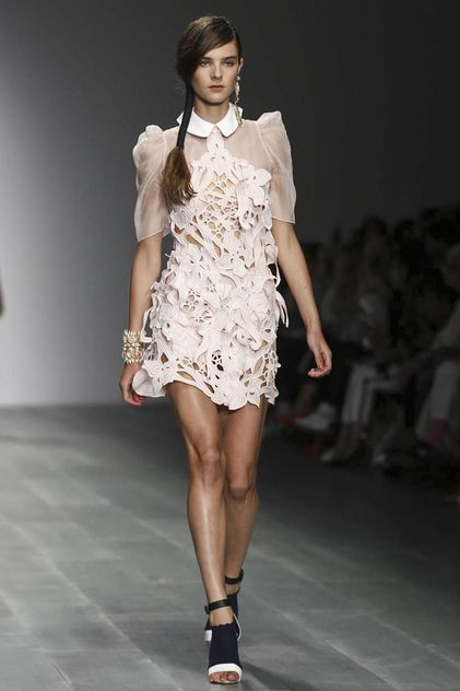 Bora Aksu Ready To Wear Spring Summer 2015 London - love the simplicity of the white garment and effectiveness of how cutting areas away have manipulated the overall structure.