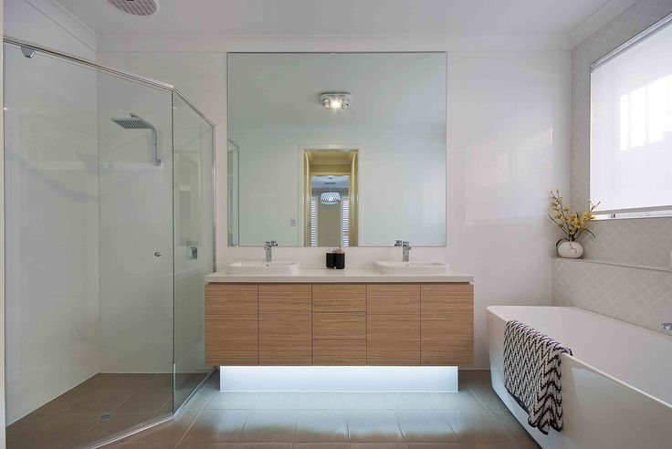 The Rockleigh Display Home by Rossdale Homes http://www.rossdalehomes.com.au/home-designs/traditional/show/rockleigh #rossdalehomes #weeklyhometrends #design #styling #homedecor #bathroominspo #inspiration #timbervanity #doublebasins #backtowallbath #freestandingbath #caroma