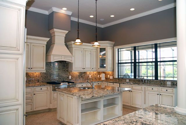 Off white kitchen cabinets with antique finish home for Best white color to paint kitchen cabinets