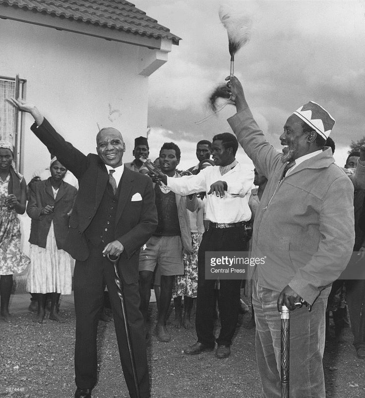 Dr Hastings Banda (left) leader of the Malawi Congress Party and Jomo Kenyatta of Kenya waving to the crowds after the latter's release from prison for alleged complicity in Mau Mau activities.