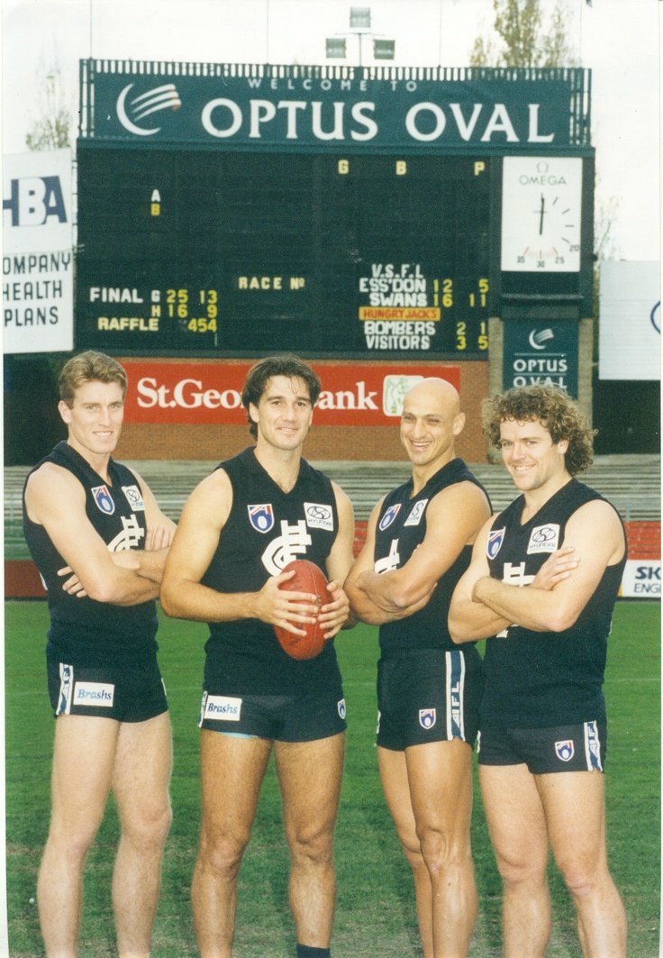 Michael Sexton, Stephen Silvagni, Milham Hanna and Fraser Brown by the old scoreboard, circa 1995.