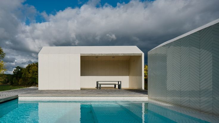 Chevron-patterned parquet covers swimming pools and spa house by Claesson Koivisto Rune
