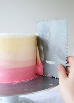 Step by step tutorial on how to do ombre icing on a cake.