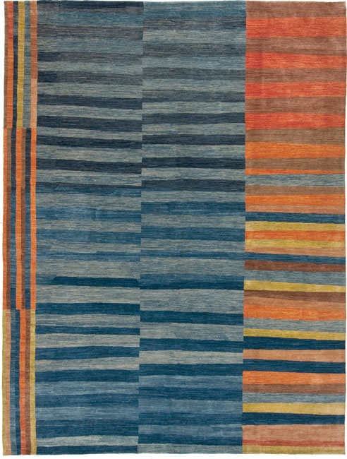 This is a rug but seeing as I knit, this is great inspiration of a cool knit blanket or wrap.  Mm hmm.