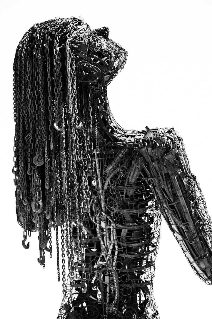 This massive figurative installation by mixed media artist Karen Cuolito stands a staggering 30 feet high. The California-based sculptor's towering figure of a woman titled Ecstasy is made of 9 tons of salvaged steel. The sculpture depicts an emotive woman who has slung her head back in a state of euphoria. She is meant to embody passion, with her tilted head and emotional stance.