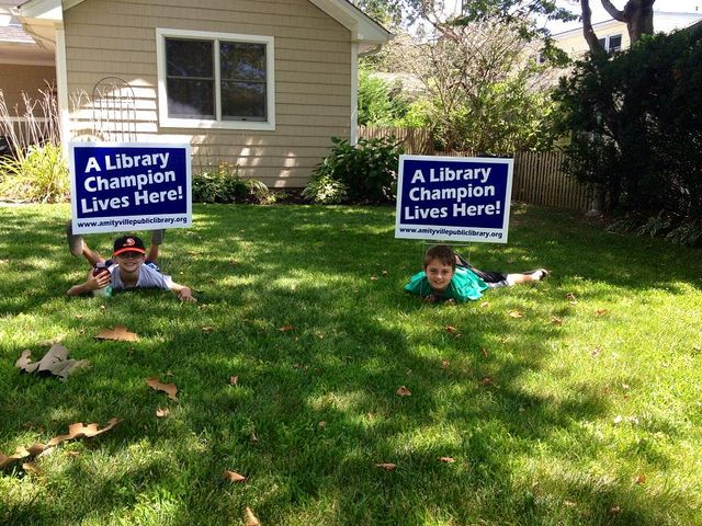 Upon completion of the Summer Reading Program kids are awarded a special Library Champion sign for their achievements.