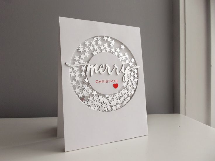 Love the simple pop of red on the sentiment and the heart, leaving the rest of the card all white and silver.