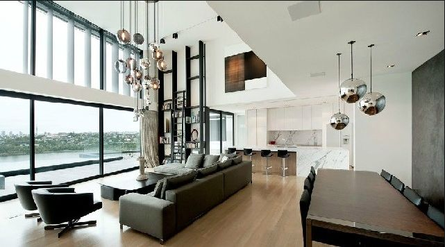 Lights in the living area and over the dining table in the same design