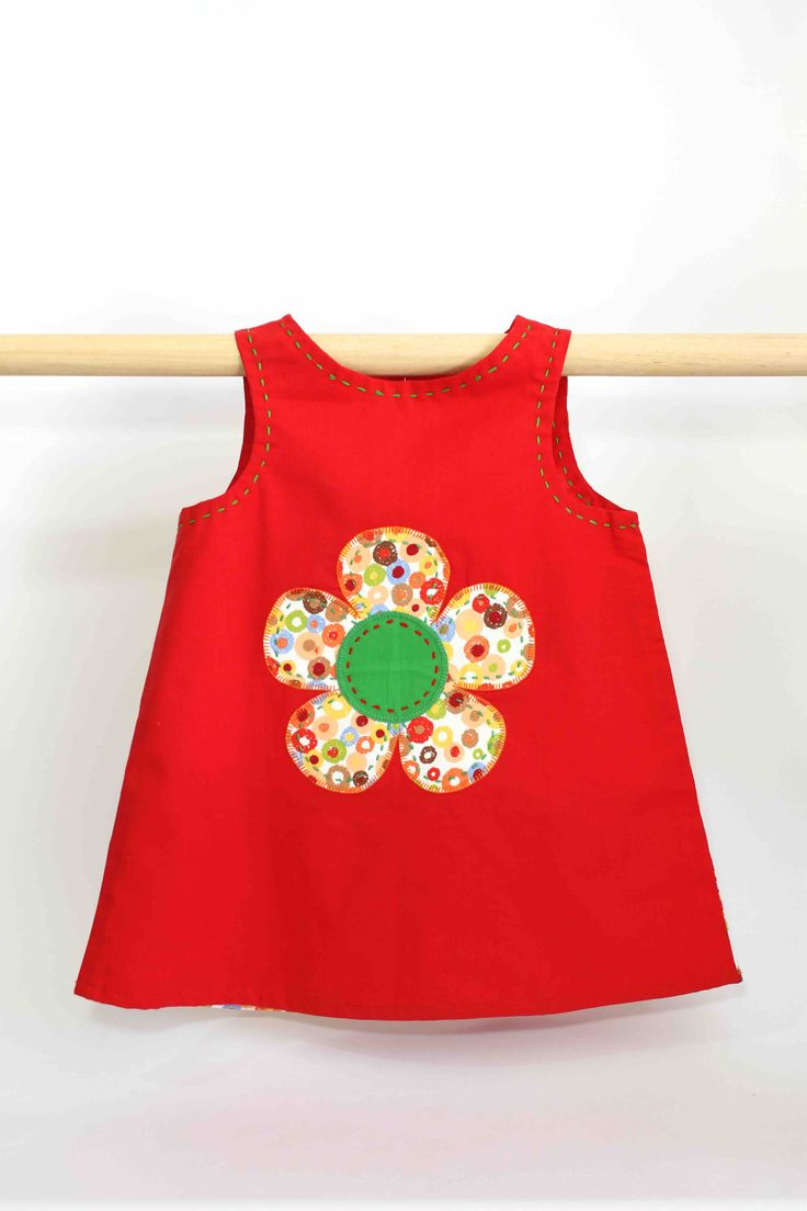 Red Spotty Flower Dress: This super cute summer dress not only looks great on kids but is also comfortable to wear and easy to clean, making it perfect for all occasions and still allowing a kid to be a kid.
