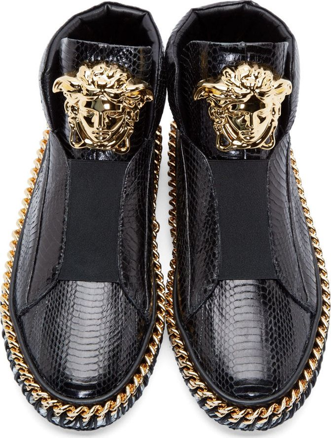 Versace Black Snakeskin Medusa Sneakers with golden chunky chains.