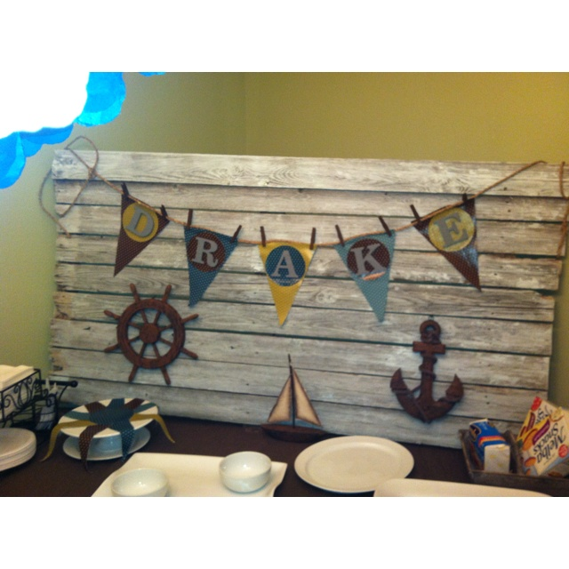 Baby Boy nautical theme shower.  The wood was an old piece of fence with a paint wash on it.  Awesome!