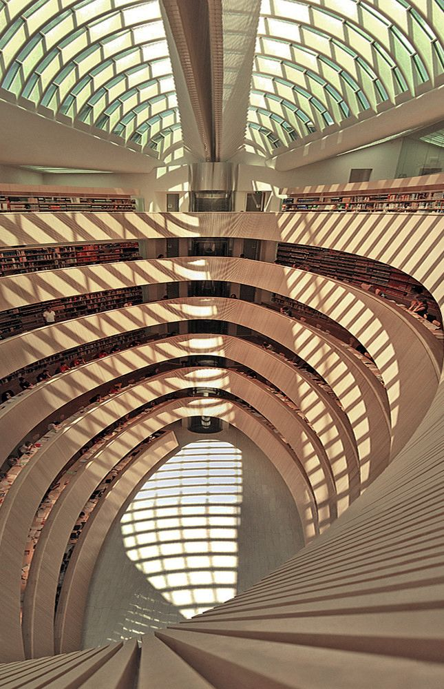 Zurich University Law Library by Santiago Calatrava  The whole intervention is more of a giant piece of wooden furniture placed in the atrium of the existing building.