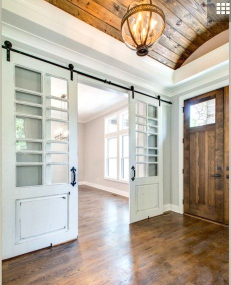 white distressed barn door with multiple window panes made to order from reclaimed barn wood